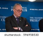 Small photo of Washington, DC - February 27, 2017: Senate Minority Leader Chuck Schumer speaks to a press conference at the National Press Club