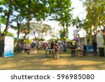 abstract blur people in park... | Shutterstock . vector #596985080