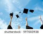 graduates throwing graduation... | Shutterstock . vector #597003938
