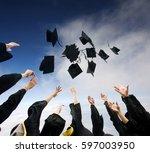 high school graduates tossing... | Shutterstock . vector #597003950