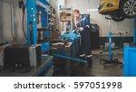 worker male caucasian grinding... | Shutterstock . vector #597051998