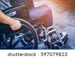Small photo of Paralyzed man using his wheelchair with light filter