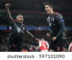 Small photo of LONDON, ENGLAND - MARCH 7, 2017: Arturo Vidal and Robert Lewandowski celebrate after a goal during the UEFA Champions League Round of 16 game between Arsenal FC and Bayern Munich at Emirates Stadium.