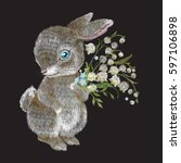 embroidery bunny with a bouquet ... | Shutterstock .eps vector #597106898