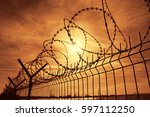 Prison Barbed Wire Fence At...