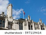 great britain s flag sits on a... | Shutterstock . vector #597119414