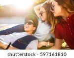 a group of friends enjoying... | Shutterstock . vector #597161810