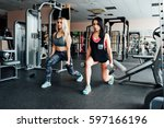 two athletic girls doing... | Shutterstock . vector #597166196