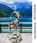 Small photo of ABKHAZIA, LAKE RITSA - JULY 29, 2015: Statue of the goat at the lake Ritsa, Republic of Abkhazian, Gudauta District