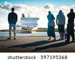 big ferry ship arriving in port ... | Shutterstock . vector #597195368