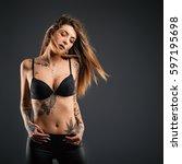 beautiful woman studio portrait ... | Shutterstock . vector #597195698