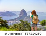 girl tourist taking a photo on... | Shutterstock . vector #597214250