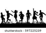 silhouette of children jumping... | Shutterstock .eps vector #597225239