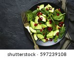 avocado salad with baby spinach ... | Shutterstock . vector #597239108