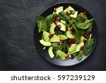 avocado salad with baby spinach ... | Shutterstock . vector #597239129