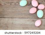Colored Easter Eggs On A Woode...