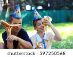kids having a birthday party at ... | Shutterstock . vector #597250568