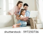 smiing parents and focused... | Shutterstock . vector #597250736