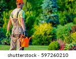 Gardener and His Garden Job To Do. Caucasian Professional Landscaper. - stock photo