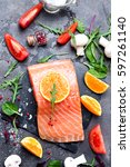 salmon fillet with fresh... | Shutterstock . vector #597261140