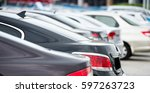 many cars parked in a row.  | Shutterstock . vector #597263723