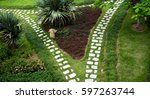 stone walkway winding in garden  | Shutterstock . vector #597263744