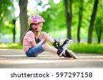 pretty little girl learning to... | Shutterstock . vector #597297158