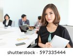 business colleagues in... | Shutterstock . vector #597335444