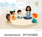 smiling kindergarten teacher... | Shutterstock .eps vector #597345800