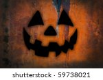 halloween black jack-o-lantern on dark old orange concrete background - stock photo