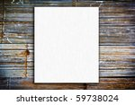 white new blank paper on dark old wood background - stock photo