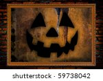 halloween jack-o-lantern in golden frame on brick background - stock photo