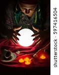 female fortuneteller with her... | Shutterstock . vector #597416504