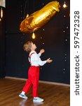 little boy in white shirt  red... | Shutterstock . vector #597472328