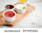classic set of sauces in white... | Shutterstock . vector #597495560