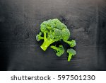 fresh broccoli on dark wooden... | Shutterstock . vector #597501230
