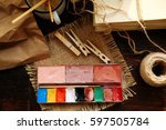 paints and brushes on sackcloth. | Shutterstock . vector #597505784