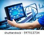 worker programming print... | Shutterstock . vector #597513734