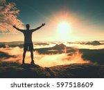 happy man gesture of triumph... | Shutterstock . vector #597518609