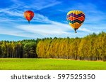 balloons flew over the forests... | Shutterstock . vector #597525350