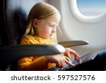 adorable little girl traveling... | Shutterstock . vector #597527576