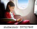 adorable little girl traveling... | Shutterstock . vector #597527849
