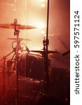 Small photo of Live rock music background, rock drum set. Warm toned closeup vertical photo, soft selective focus