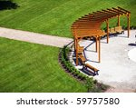 Garden with wooden construction and benches - stock photo