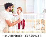 happy father playing with... | Shutterstock . vector #597604154