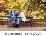 caring nurse talking with... | Shutterstock . vector #597617204