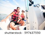 young couple on boat | Shutterstock . vector #597637550