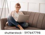 cheerful blonde woman resting... | Shutterstock . vector #597647798