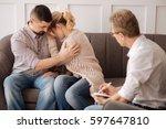 handsome sad man hugging his... | Shutterstock . vector #597647810