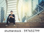 businesspeople use cell phones... | Shutterstock . vector #597652799